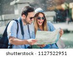 tourist couple in love enjoying ... | Shutterstock . vector #1127522951