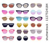 set of colorful sunglasses... | Shutterstock . vector #1127524184