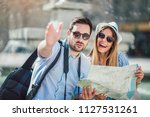 tourist couple in love enjoying ... | Shutterstock . vector #1127531261
