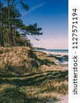 beach and blue sky | Shutterstock . vector #1127571194
