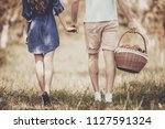 close up. young couple walking... | Shutterstock . vector #1127591324