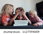 boy try to read books  do... | Shutterstock . vector #1127594009