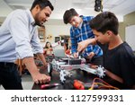 teacher with male pupils... | Shutterstock . vector #1127599331
