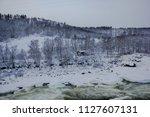 almost frozen stream in the... | Shutterstock . vector #1127607131