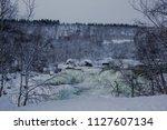 almost frozen stream in the... | Shutterstock . vector #1127607134