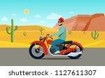 man riding a motorcycle. desert ... | Shutterstock .eps vector #1127611307
