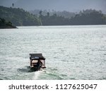 the boat is in the lake. | Shutterstock . vector #1127625047