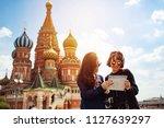two asian traveler girls are... | Shutterstock . vector #1127639297