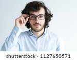 serious young dark haired man... | Shutterstock . vector #1127650571