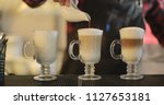 the barista is making coffee at ...   Shutterstock . vector #1127653181