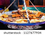grilled sausages at christmas... | Shutterstock . vector #1127677934