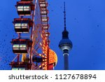 ferris wheel and fernsehturm at ... | Shutterstock . vector #1127678894
