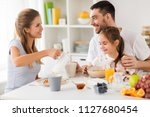 family  eating and people... | Shutterstock . vector #1127680454