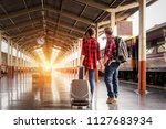 young traveling backpacker on... | Shutterstock . vector #1127683934