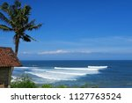 hut and palm at balean surf... | Shutterstock . vector #1127763524