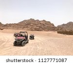 a lot of four wheeled powerful...   Shutterstock . vector #1127771087