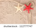 Starfishes With Rope On Sand