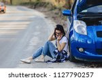 Girl Is Sitting By Car With An...