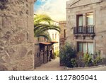typical aegean architecture and ... | Shutterstock . vector #1127805041