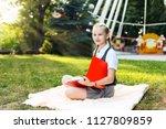 student schoolgirl with... | Shutterstock . vector #1127809859