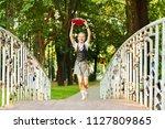 student schoolgirl happy with... | Shutterstock . vector #1127809865