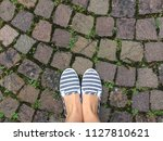 two feet standing on stone path ...   Shutterstock . vector #1127810621