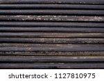 oil drill pipe. rusty drill... | Shutterstock . vector #1127810975