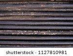oil drill pipe. rusty drill... | Shutterstock . vector #1127810981