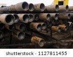 oil drill pipe. rusty drill... | Shutterstock . vector #1127811455