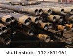 oil drill pipe. rusty drill... | Shutterstock . vector #1127811461
