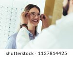 ophthalmologist doing a visual... | Shutterstock . vector #1127814425