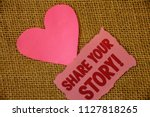 Small photo of Conceptual hand writing showing Share Your Story Motivational Call. Business photo text Experience Nostalgia Memory Personal Text pink torn paper note heart love message letter.