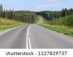 asphalt road across the forest...   Shutterstock . vector #1127829737