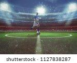 soccer player hits the ball... | Shutterstock . vector #1127838287