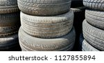 pile of used tyres    Shutterstock . vector #1127855894