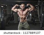 handsome strong bodybuilder... | Shutterstock . vector #1127889137