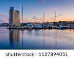 a marina at sunset  at the... | Shutterstock . vector #1127894051