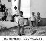 Small photo of KHAYELITSHA, CAPE TOWN SOUTH AFRICA MAY 22 2007: A unidentified group of young children play on a street of Khayelitsha township in Western Cape reputed to be the largest and fastest growing in SA.