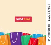 shopping colorful shopping bag... | Shutterstock .eps vector #1127957537