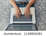 woman typing on laptop and... | Shutterstock . vector #1128003281