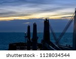 view from cargo ship at sea to... | Shutterstock . vector #1128034544