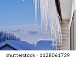 snowy landscape and icicle | Shutterstock . vector #1128061739
