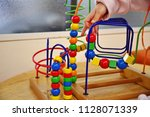 children playing with colorful... | Shutterstock . vector #1128071339