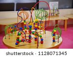 children playing with colorful... | Shutterstock . vector #1128071345
