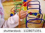 children playing with colorful... | Shutterstock . vector #1128071351