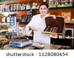 young shop assistant... | Shutterstock . vector #1128080654