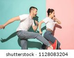 a couple of young funny and... | Shutterstock . vector #1128083204