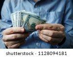 cash in hands. profits  savings.... | Shutterstock . vector #1128094181