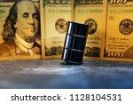 oil barrel and us dollar oil...   Shutterstock . vector #1128104531