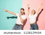 a couple of young funny and... | Shutterstock . vector #1128129434
